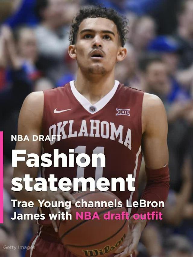 Projected NBA lottery pick and former Oklahoma point guard Trae Young channels LeBron James with suit and shorts outfit.