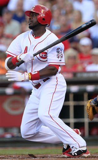 Cincinnati Reds' Brandon Phillips watches his RBI single in the first inning of a baseball game against the Detroit Tigers, Friday, June 8, 2012, in Cincinnati. (AP Photo/Al Behrman)