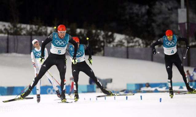 Nordic Combined Events - Pyeongchang 2018 Winter Olympics - Men's Individual 10 km Final - Alpensia Cross-Country Skiing Centre - Pyeongchang, South Korea - February 20, 2018 - Johannes Rydzek of Germany, Fabian Riessle of Germany, Eric Frenzel of Germany and Jarl Magnus Riiber of Norway approach the finish line. REUTERS/Kai Pfaffenbach