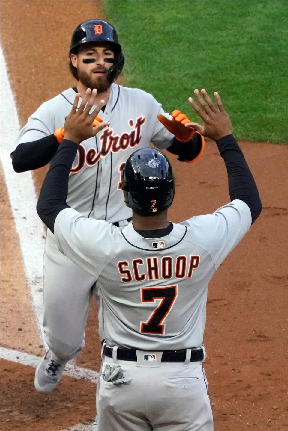Detroit Tigers Eric Haase, rear, and Jonathan Schoop celebrates Haase's two-run home run off Minnesota Twins pitcher J.A. Happ during the fourth inning of a baseball game Thursday, July 8, 2021, in Minneapolis.