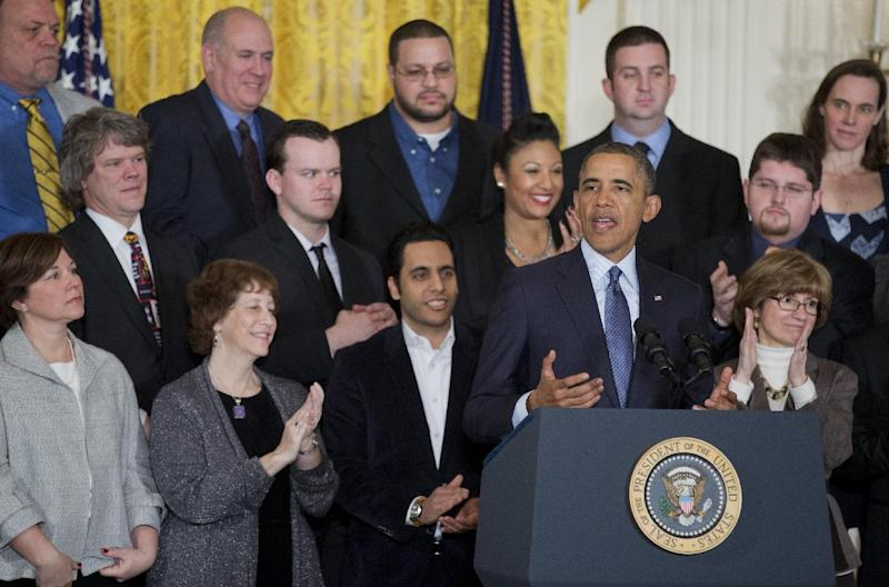 President Barack Obama, surrounded by workers and supportive business leaders, speaks during a signing ceremony in the East Room of the White House in Washington, Thursday, March 13, 2014, for a Presidential Memorandum directing Labor Secretary Tom Perez to modernize overtime protections. Obama is bypassing Congress and orders changes in overtime rules so employers would required to pay millions more for extra time they put in on the job. (AP Photo/Manuel Balce Ceneta)