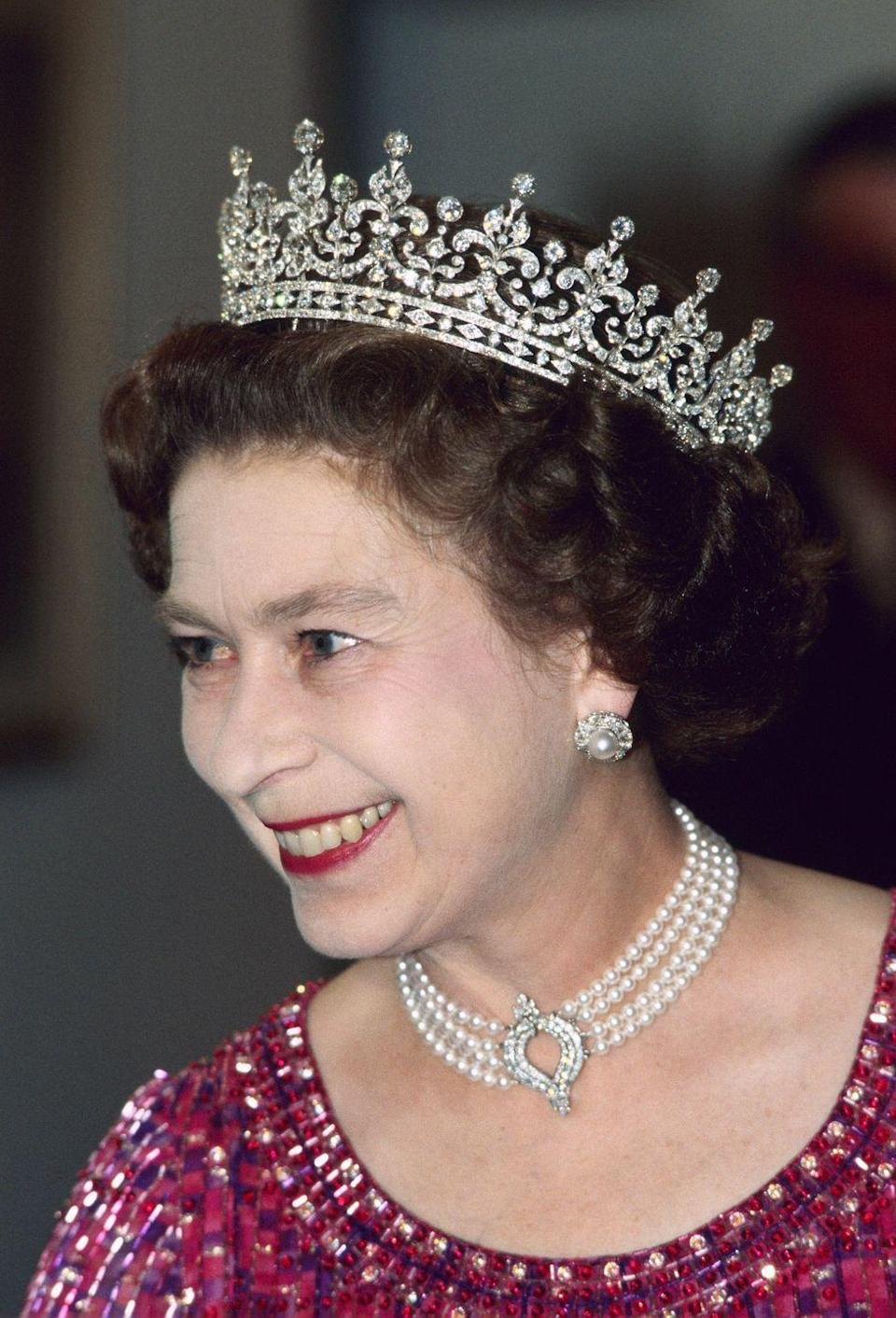 """<p>This four-strand pearl choker with diamond pendant was commissioned for the Queen by the Japanese government in the early 80's; she's seen wearing it here on November 16, 1983. It's been <a href=""""http://www.townandcountrymag.com/style/jewelry-and-watches/a13819159/kate-middleton-queen-pearl-choker/"""" rel=""""nofollow noopener"""" target=""""_blank"""" data-ylk=""""slk:seen on the Duchess of Cambridge"""" class=""""link rapid-noclick-resp"""">seen on the Duchess of Cambridge</a> as well.</p>"""