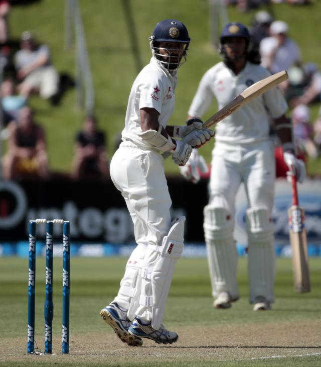 India's Shikhar Dhawan plays a shot during the first innings on day two of the second international test cricket match against New Zealand at the Basin Reserve in Wellington, February 15, 2014. REUTERS/Anthony Phelps (NEW ZEALAND - Tags: SPORT CRICKET)