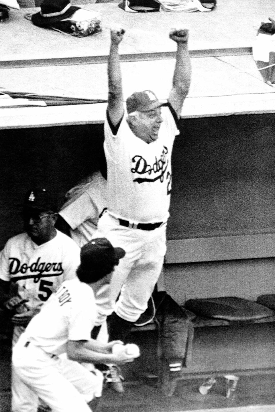 FILE - Los Angeles Dodgers manager Tom Lasorda leaps from the dugout as the Dodgers beat the New York Yankees, 8-7 to tie the World Series at two games apiece in Los Angeles, in this Saturday, Oct. 24, 1981, file photo. Lasorda, the fiery Hall of Fame manager who guided the Los Angeles Dodgers to two World Series titles and later became an ambassador for the sport he loved during his 71 years with the franchise, has died. He was 93. The Dodgers said Friday, Jan. 8, 2021, that he had a heart attack at his home in Fullerton, California. Resuscitation attempts were made on the way to a hospital, where he was pronounced dead shortly before 11 p.m. Thursday. (AP Photo/File)