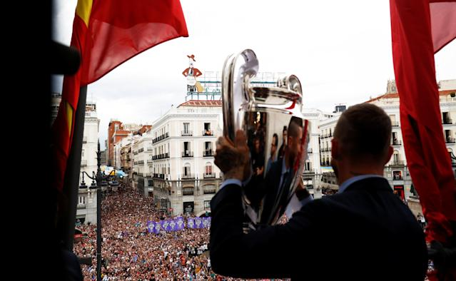 Soccer Football - Real Madrid celebrate winning the Champions League Final - Madrid, Spain - May 27, 2018 Real Madrid's Sergio Ramos celebrates with the Champions League trophy during a ceremony REUTERS/Javier Barbancho