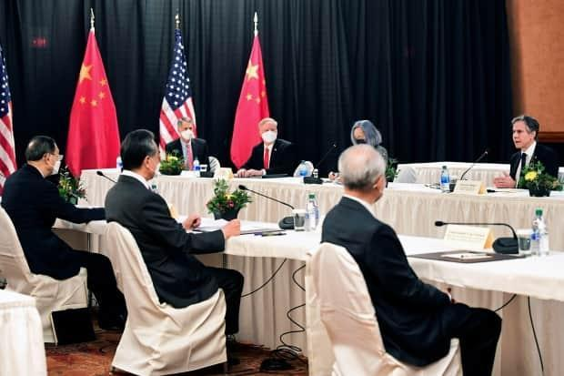 U.S. Secretary of State Antony Blinken, right, seen here at the meeting this week in Alaska, defended his country after hearing the Chinese complaints. He said the U.S. admits its problems, discusses them openly, and that helps it improve.