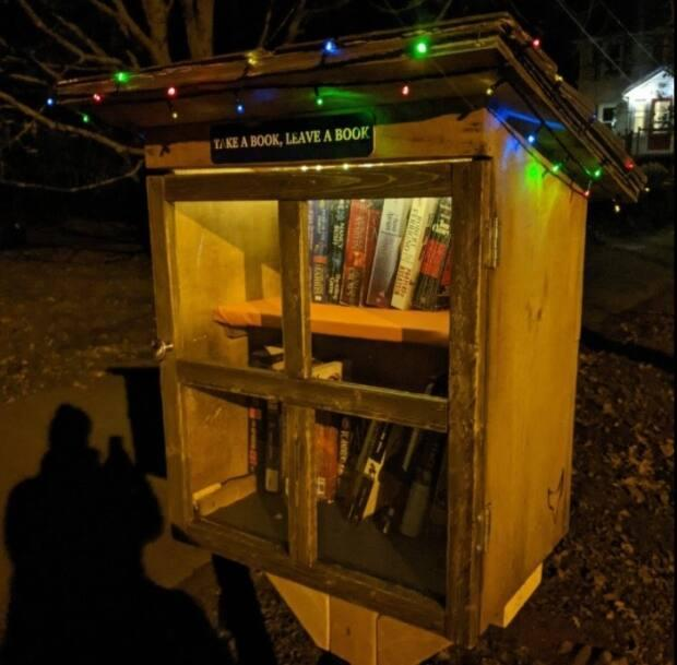Keith Burgoyne's tiny library is open for business at night, too.