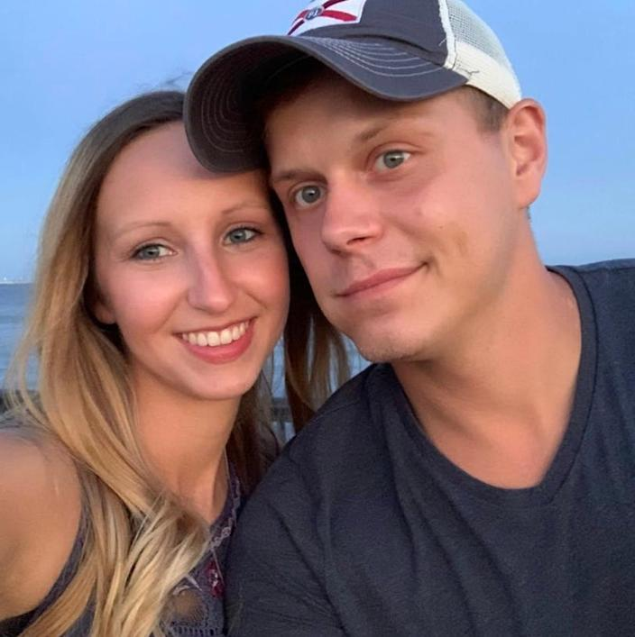 Audrey and Josh Williams pose for a photograph together. The couple's son recently rescued Josh from the water at Quietwater Beach after a diving accident.