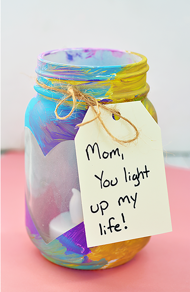 """<p>After painting these adorable votive vases for mom, don't forget to add a sweet message on the tag. </p><p><strong>Get the tutorial at <a rel=""""nofollow"""" href=""""http://www.iheartartsncrafts.com/mothers-day-mason-jar-votives/"""">I Heart Arts N Crafts</a>. </strong></p>"""
