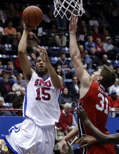 SMU's Cannen Cunningham (15) attempts a shot over Utah's Dallin Bachynski (31) in the first half of an NCAA college basketball game on Wednesday, Nov. 28, 2012, in Dallas. (AP Photo/Tony Gutierrez)