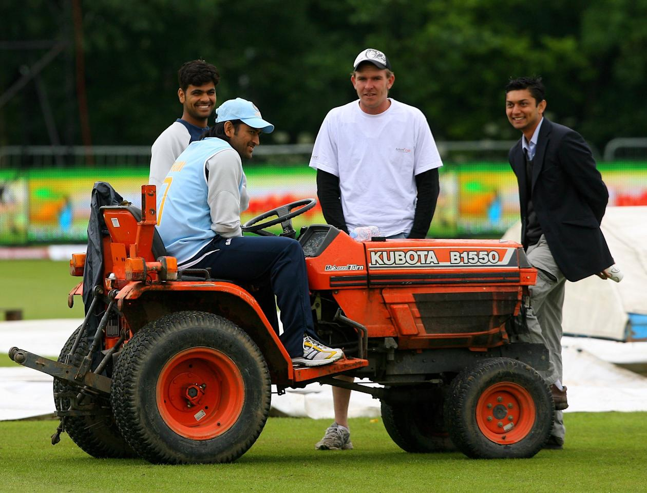 BELFAST, UNITED KINGDOM - JULY 01: Indian player Mahendra Singh Dhoni sits on the tractor as the players await the start of the delayed 3rd One Day International between India and South Africa at the Civil Service Cricket Club in Belfast,Northern Ireland.  (Photo by Stu Forster/Getty Images)