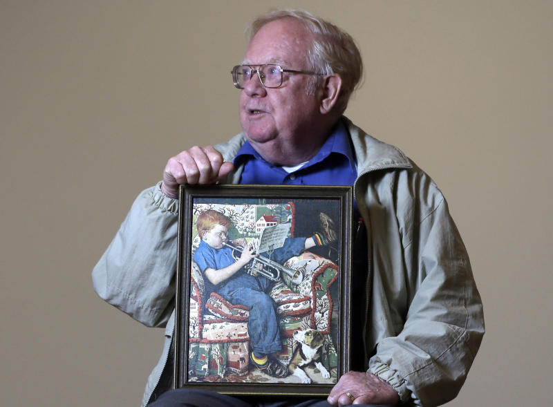 Tom Paquin of North Bennington, Vt., poses with a 1950 Saturday Evening Post illustration by Norman Rockwell for which he modeled at the Bennington Museum on Friday, Sept. 28, 2012, in Bennington, Vt. (AP Photo/Mike Groll)