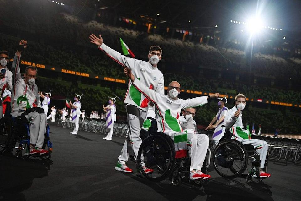 Teams arriving for the opening ceremony for the Tokyo 2020 Paralympic Games at the Olympic Stadium in Tokyo on 24 August (AFP via Getty Images)