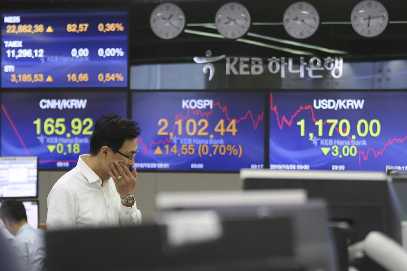 A currency trader watches monitors at the foreign exchange dealing room of the KEB Hana Bank headquarters in Seoul, South Korea, Monday, Oct. 28, 2019. (AP Photo/Ahn Young-joon)