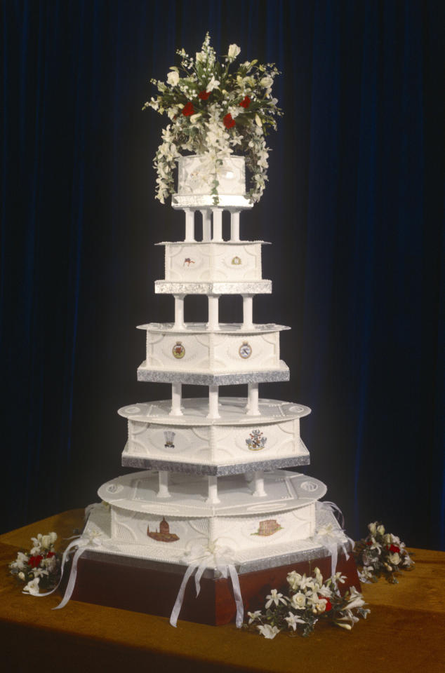 <p>For Charles and Diana's wedding in 1981, David Avery, the head baker at the Royal Naval cooking school, rustled up this five-tier show-stopper.<em> [Photo: Getty]</em> </p>