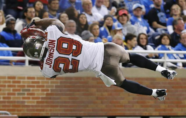 Tampa Bay Buccaneers cornerback Leonard Johnson (29) jumps into the end zone after a 48-yard interception for a touchdown during the first half of an NFL football game against the Detroit Lions in Detroit, Sunday, Nov. 24, 2013. (AP Photo/Paul Sancya)