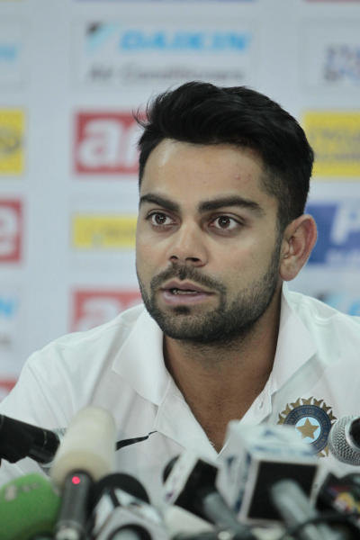 India cricket team captain Virat Kohli addresses a press conference ahead of the Asia Cup tournament in Dhaka, Bangladesh, Sunday, Feb. 23, 2014. Pakistan plays Sri Lanka in the opening match of the five nation one day cricket event that begins Tuesday. (AP Photo/A.M. Ahad)