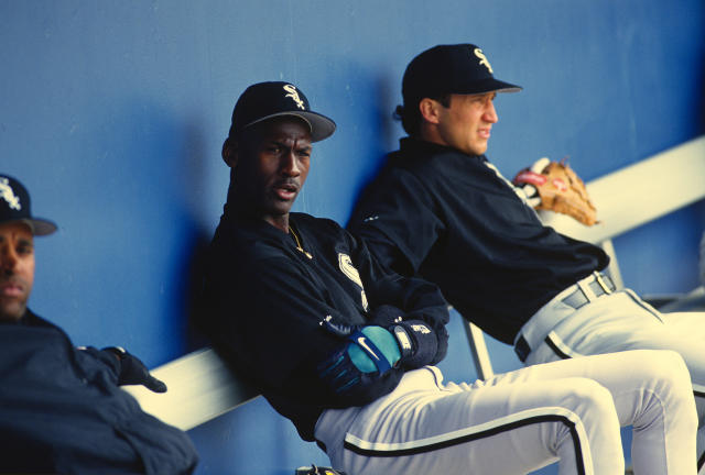 Michael Jordan looks on from the bench during a Birmingham Barons game. (Photo by Focus on Sport/Getty Images)