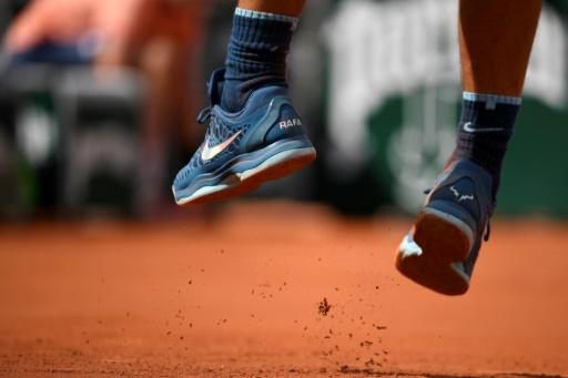 Shoe in!: Details of his shoes as Spain's Rafael Nadal serves