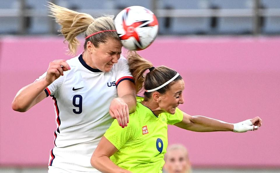 Lindsey Horan battles for the ball with Sweden's Kosovare Asllani in the first half.