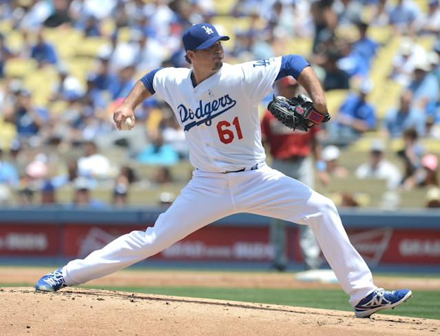 Los Angeles Dodgers' Josh Beckett pitches in the first inning a baseball game against the Arizona Diamondbacks, Sunday, June 15, 2014, in Los Angeles. (AP Photo/Jayne Kamin-Oncea)