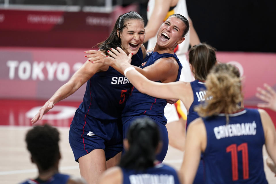 Serbia's Sonja Vasic, left, and Ana Dabovic celebrate at the end of a women's basketball quarterfinal round game against China at the 2020 Summer Olympics, Wednesday, Aug. 4, 2021, in Saitama, Japan. (AP Photo/Charlie Neibergall)