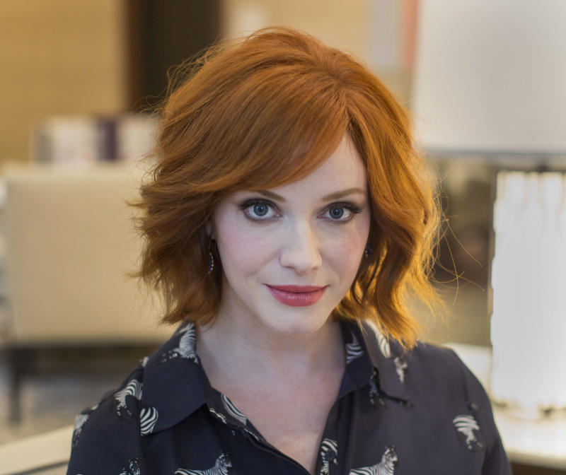 "Actress Christina Hendricks, from the AMC series ""Mad Men,"" poses for a portrait at the Langham Hotel in Chicago, on Thursday, Aug. 22, 2013. Hendricks is in Chicago to host the opening of the city's Magnificent Mile Shopping Festival. (AP Photo/Scott Eisen)"