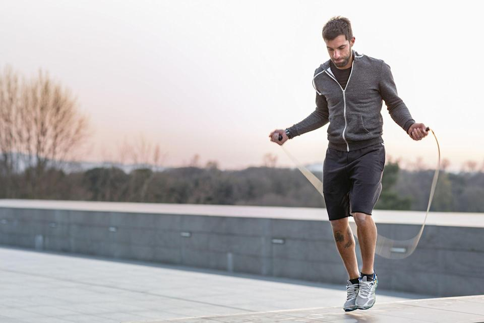 """<p>Jumping rope is one of the best cardio workouts you can do on days when you're not running. As <em>Runner's World</em> <a href=""""https://www.runnersworld.com/training/a28703421/jump-rope-benefits/"""" rel=""""nofollow noopener"""" target=""""_blank"""" data-ylk=""""slk:previously reported"""" class=""""link rapid-noclick-resp"""">previously reported</a>, jumping rope uses muscles all over your body, from your quads and calves to your upper body. In addition, your core and ankles—stabilizing muscles—get a great workout as you jump.<br></p><p>""""A jump rope workout is a full-body workout from your calves to your mind,"""" <a href=""""https://amandakloots.com/"""" rel=""""nofollow noopener"""" target=""""_blank"""" data-ylk=""""slk:Amanda Kloots"""" class=""""link rapid-noclick-resp"""">Amanda Kloots</a>, celebrity trainer and creator of <a href=""""https://amandakloots.com/new-products/ak-jump-rope-1"""" rel=""""nofollow noopener"""" target=""""_blank"""" data-ylk=""""slk:AK! Rope"""" class=""""link rapid-noclick-resp"""">AK! Rope</a>, <a href=""""https://www.runnersworld.com/training/a28703421/jump-rope-benefits/"""" rel=""""nofollow noopener"""" target=""""_blank"""" data-ylk=""""slk:told Runner's World"""" class=""""link rapid-noclick-resp"""">told <em>Runner's World</em></a>. """"It builds your endurance, stamina, and coordination.""""</p><p>All you need is a little bit of space and a rope to get in an incredible sweat session. One easy way to make your jump rope workout even harder is to use a weighted jump rope for some extra resistance. Typically weighing a pound or more, a weighted jump rope will take your workout to another level. (Looking for a non-weighted jump rope? <a href=""""https://www.menshealth.com/technology-gear/g25337471/best-jump-ropes-for-exercise-workouts/"""" rel=""""nofollow noopener"""" target=""""_blank"""" data-ylk=""""slk:Here are 15 of the best"""" class=""""link rapid-noclick-resp"""">Here are 15 of the best</a>.) Weighted jump ropes typically hold the weight in the handles, but some also have weight in the rope itself. Plus, most are adjustable in length, so you can get a customized fit.<"""