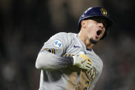Milwaukee Brewers' Willy Adames reacts after hitting a two-run home run off Colorado Rockies relief pitcher Tyler Kinley during the ninth inning of a baseball game Saturday, June 19, 2021, in Denver. (AP Photo/David Zalubowski)