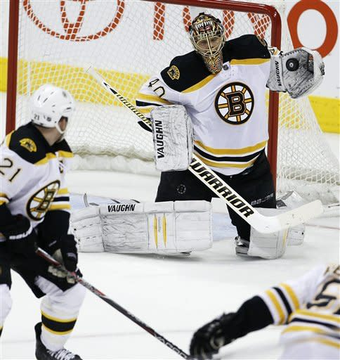 Boston Bruins goaltender Tuukka Rask makes a save against the Winnipeg Jets during the second period of an NHL hockey game, Friday, Feb. 17, 2012, in Winnipeg, Manitoba. (AP Photo/The Canadian Press, Trevor Hagan)
