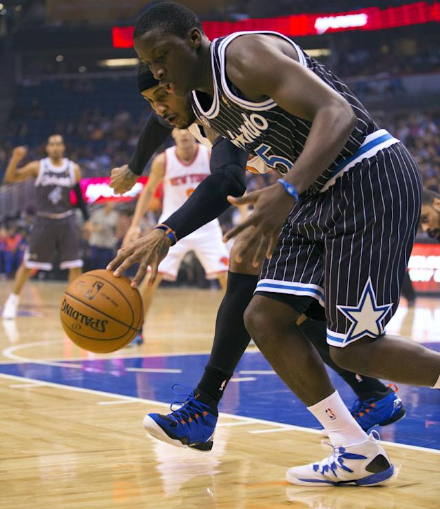 Orlando Magic's Victor Oladipo, front, and New York Knicks' Carmelo Anthony vie for a loose ball during the first half of an NBA basketball game in Orlando, Fla., Friday, Feb. 21, 2014. (AP Photo/Willie J. Allen Jr.)