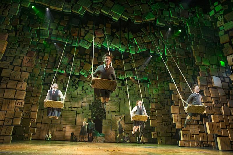 """This theater publicity image released by Boneau/Bryan-Brown shows the cast of """"Matilda, the Musical,"""" during a performance in New York. Two Broadway shows with very different audiences broke box office records last week, the kid-friendly """"Matilda, the Musical"""" and the very adult revival of Harold Pinter's """"Betrayal."""" (AP Photo/Boneau/Bryan-Brown, Joan Marcus, File)"""
