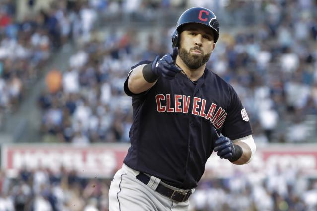 Cleveland Indians' Jason Kipnis gestures to teammates as he runs the bases after hitting a home run during the first inning of the team's baseball game against the New York Yankees on Thursday, Aug. 15, 2019, in New York. (AP Photo/Frank Franklin II)