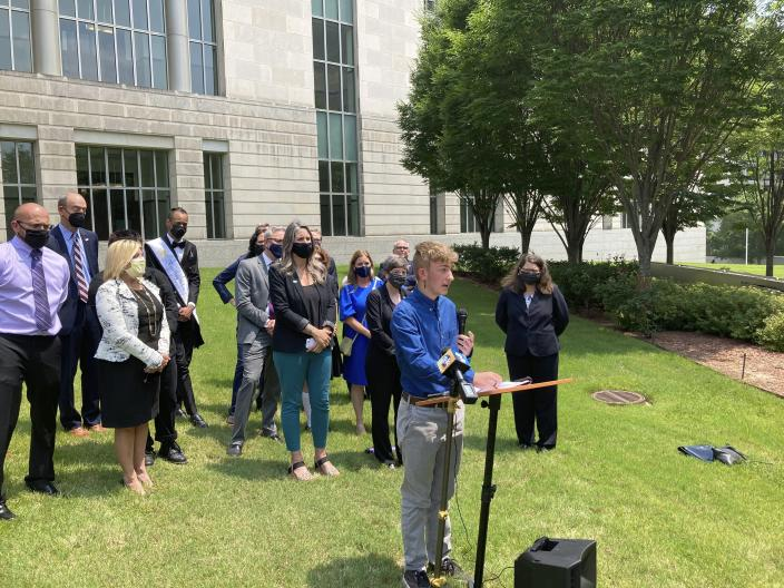 Dylan Brandt speaks at a news conference outside the federal courthouse in Little Rock, Ark., on Wednesday, July 21, 2021. Brandt, 15, has been receiving hormone treatments and is among several transgender youth who challenged a state law banning gender confirming care for trans minors. A federal judge on Wednesday blocked that law's enforcement. (AP Photo/Andrew DeMillo)