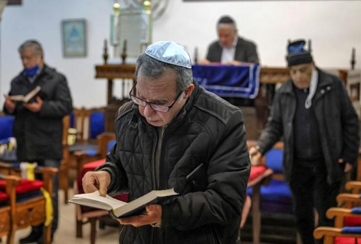 Moroccan Jews, pictured here praying at Casablanca's Em Habanim synagogue, are a community that dates back to antiquity
