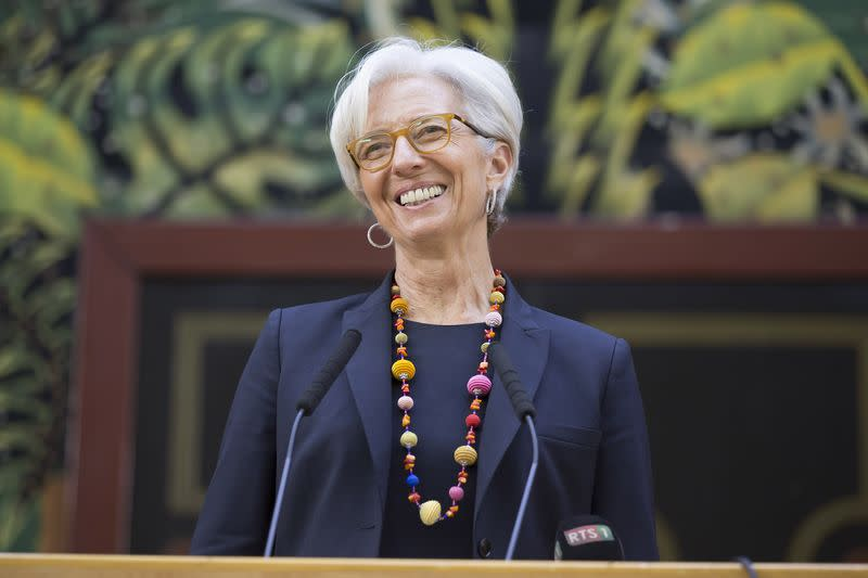 International Monetary Fund Managing Director Christine Lagarde smiles while speaking at the National Assembly in Dakar