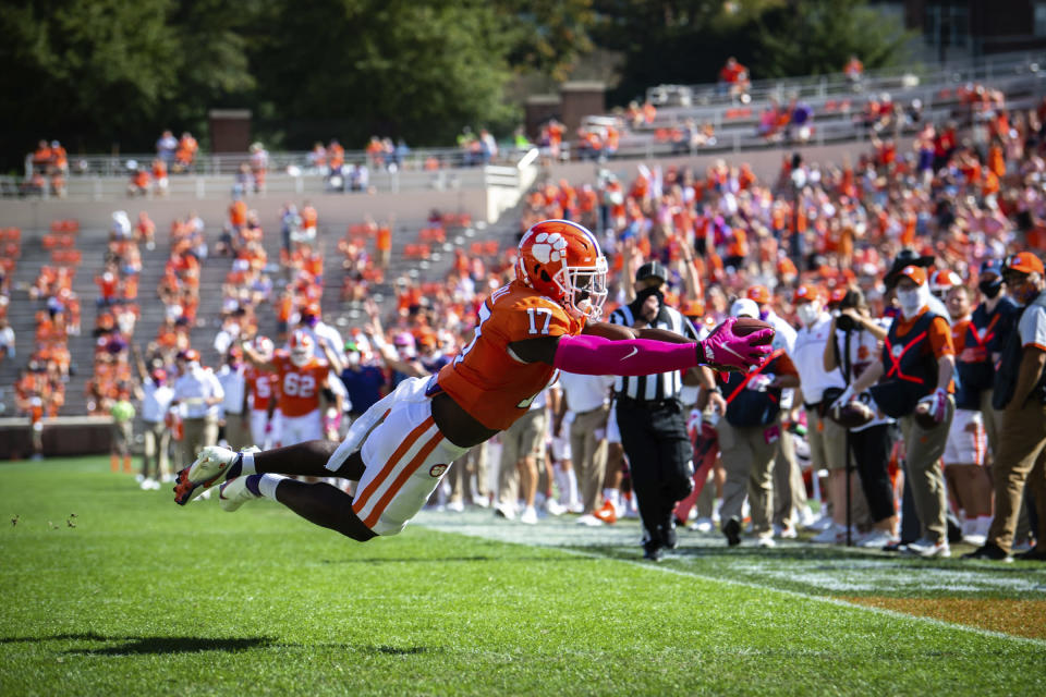 Clemson wide receiver Cornell Powell (17) dives into the end zone for a touchdown during an NCAA college football game against Syracuse in Clemson, S.C., on Saturday, Oct. 24, 2020. (Ken Ruinard/Pool Photo via AP)