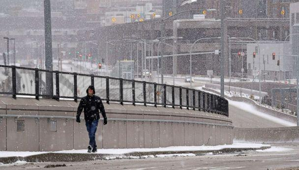 PHOTO: Dave Wilkinson, of the Washington Dept. of Transportation, checks out a new street adjacent to the brand new State Route 99 tunnel on its first day of service during a winter storm Monday morning, Feb. 4, 2019, in Seattle. (Elaine Thompson/AP)
