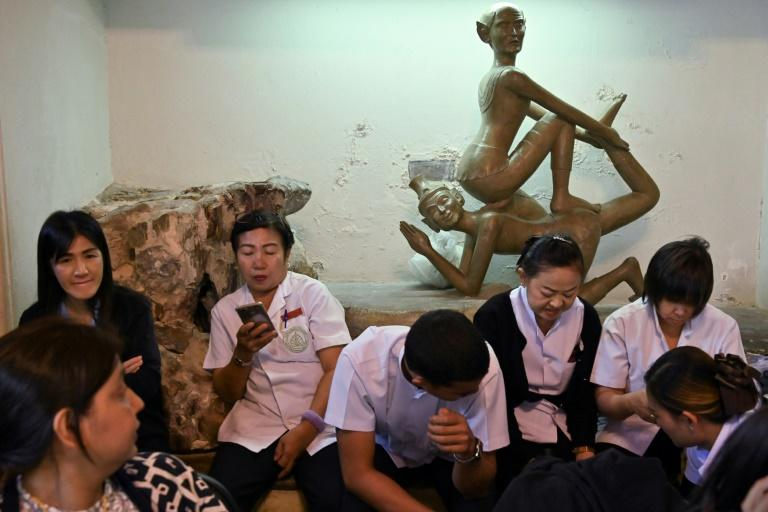 A therapist at a top-end spa in Thailand can charge around $100 an hour (AFP Photo/Romeo GACAD)