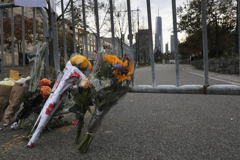 A makeshift memorial stands on a bike path in lower Manhattan on November 1, 2017 in New York City. Eight people were killed and 12 injured on October 31 when suspect 29-year-old Sayfullo Saipov intentionally drove a truck onto the path.  (John Moore via Getty Images)