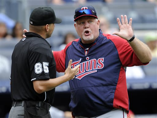 Minnesota Twins manager Ron Gardenhire argues with home plate umpire Vic Carapazza during the eighth inning of a baseball game against the New York Yankees Saturday, July 13, 2013, at Yankee Stadium in New York. (AP Photo/Bill Kostroun)
