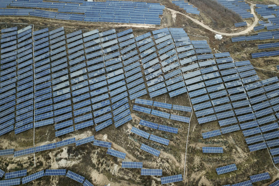FILE - In this Nov. 27, 2019, file photo, a solar panel installation is seen in Ruicheng County in central China's Shanxi Province. China's Premier Li Keqiang announced that the country would target a reduction of 18% in carbon intensity over the course of the next five years as part of the meeting of the ceremonial legislature which kicked off its annual meeting Friday, March 5, 2021. (AP Photo/Sam McNeil, File)