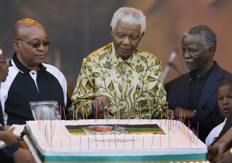 File-In this Aug. 2 2008 file photo, former South African President Nelson Mandela, flanked by African President Thabo Mbeki, right, and ANC President Jacob Zuma, left, cuts a birthday cake  at the Loftus Versfeld stadium in Pretoria, South Africa for a celebration of Mandela's 90th birthday, organized by the African National Congress. Against all odds, the party of Nelson Mandela which  has transformed a nation where just 20 years ago black South Africans could not vote, and beaches and restaurants were reserved for whites only, is celebrating its 100th anniversary in Bloemfontein Sunday Jan 8 2012.(AP Photo/Jerome Delay, file)