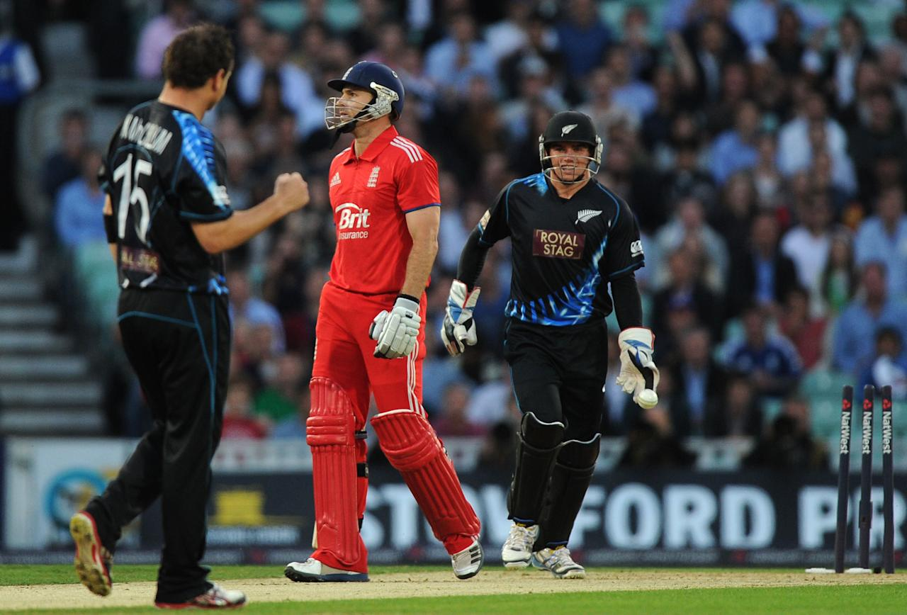 England's Michael Lumb (centre) reacts after being bowled out by New Zealand's Nathan McCullum (left) for 29 during the Natwest International Twenty20 match at the Kia Oval, London.
