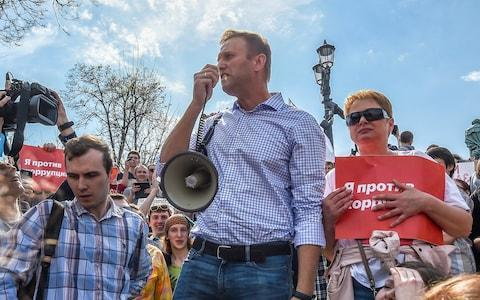 <span>Russian opposition leader Alexei Navalny attends a protest rally ahead of President Vladimir Putin's inauguration ceremony, Moscow</span> <span>Credit: Reuters </span>