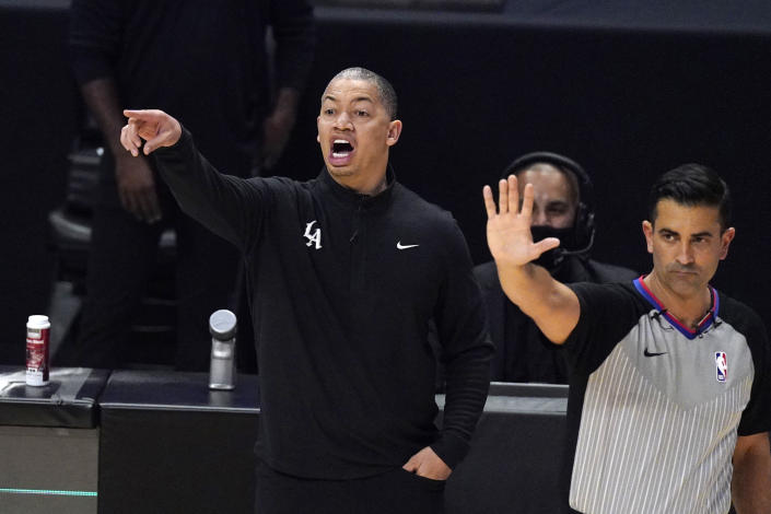 Los Angeles Clippers head coach Tyronn Lue, left, gestures during the first half in Game 1 of an NBA basketball first-round playoff series against the Dallas Mavericks Saturday, May 22, 2021, in Los Angeles. (AP Photo/Mark J. Terrill)