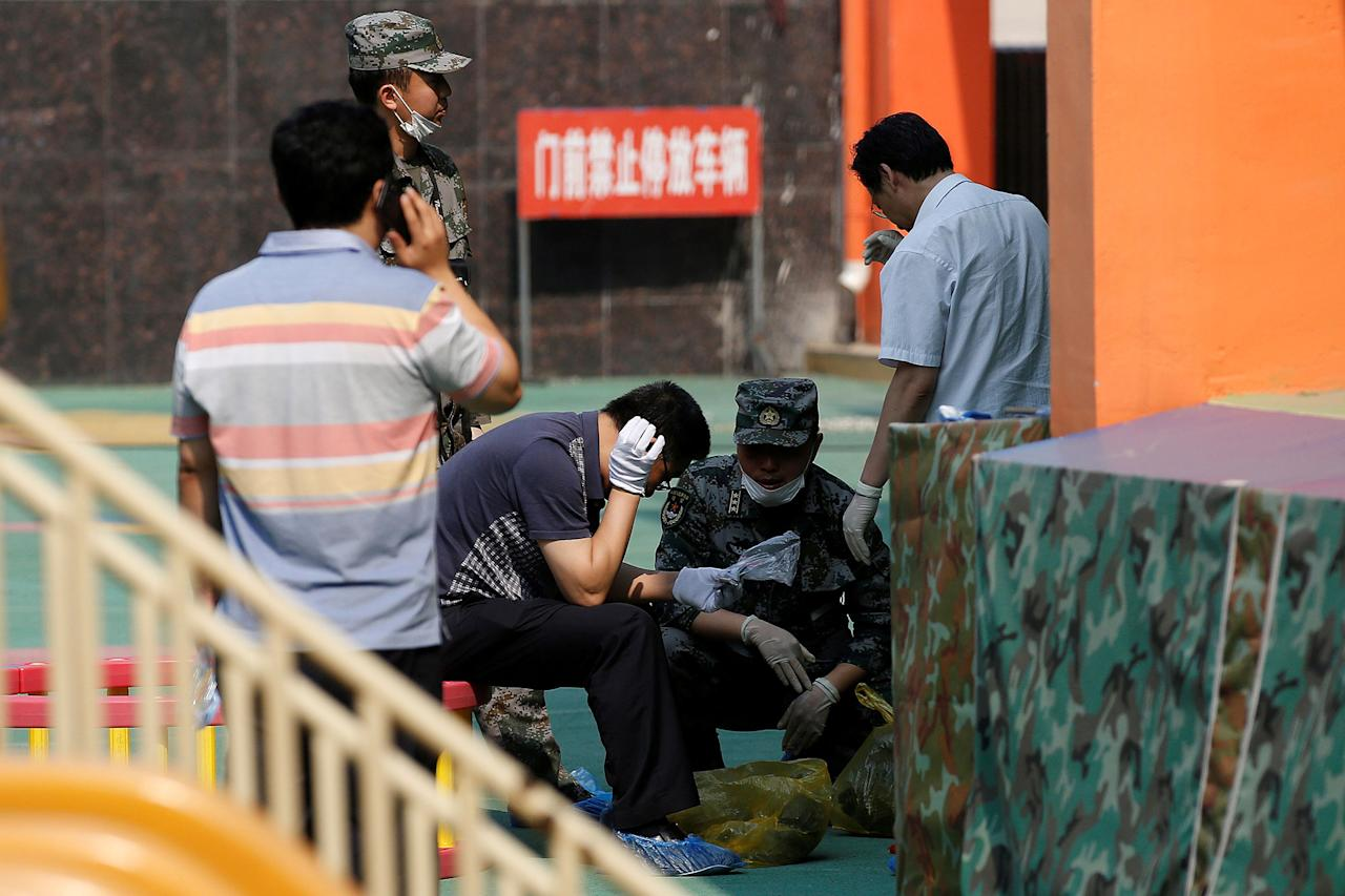 <p>Investigators work at the scene of an explosion inside a kindergarten in Fengxian County in Jiangsu Province, China , June 16, 2017. (Photo: Aly Song/Reuters) </p>