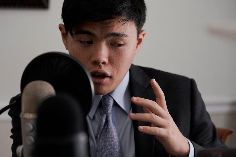 Whitman Ochiai rehearses for his podcast at his home in Great Falls, Virginia, on Aug. 2, 2021.