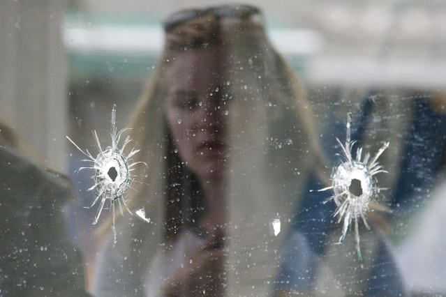 Bullet holes where a mass shooting took place near the University of California, Santa Barbara, campus, May 24, 2014. (Photo: Jae C. Hong/AP)
