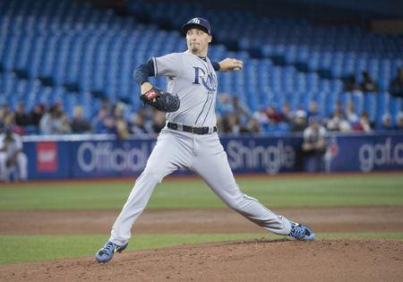FILE PHOTO: Apr 13, 2019; Toronto, Ontario, CAN; Tampa Bay Rays starting pitcher Blake Snell (4) throws a pitch during the first inning against the Toronto Blue Jays at Rogers Centre. Mandatory Credit: Nick Turchiaro-USA TODAY Sports